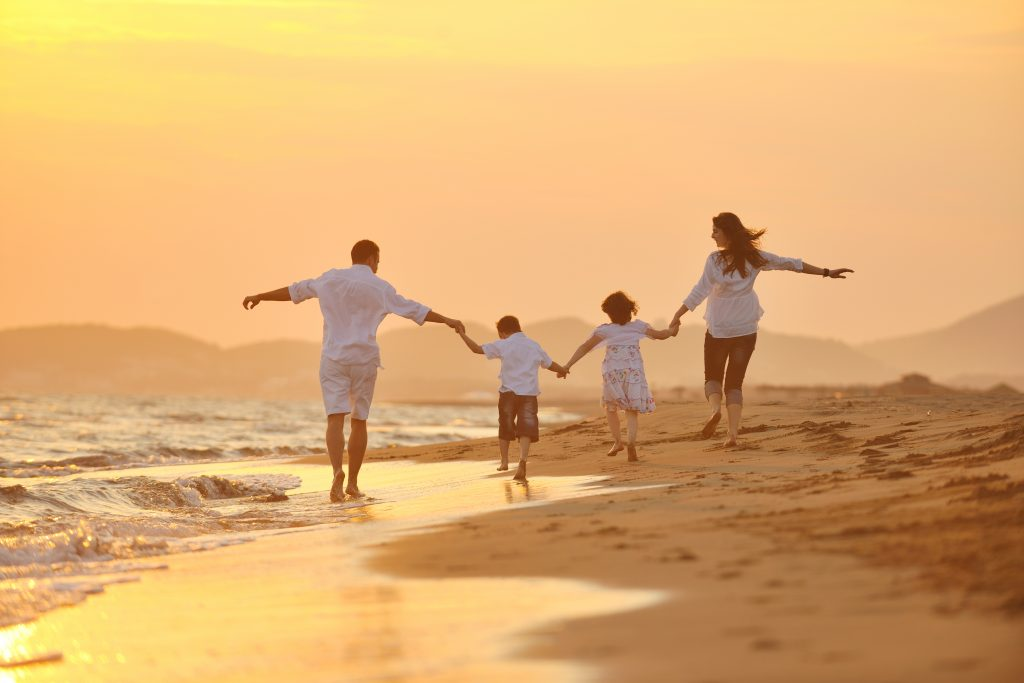 happy healthy family on beach